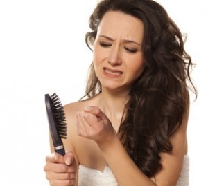 girl is very nervous about the loss of hair on white background